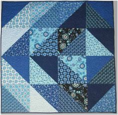 "Sapphire. FREE Quilt Pattern Design by Stephanie Sims for Clothworks. Featuring fabrics from the Sapphire Collection by Skipping Stones Studio. Lap Quilt Finished size: 61"" x 61"""