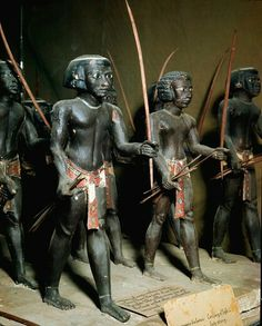 11th dynasty egyptian archers. , from the Tomb of Mesehti, Assyut, Egypt. Painted wood, H5.5 cm, 11-12th Dynasty, c.2000 BC. Egyptian Museum, Cairo, Egypt.