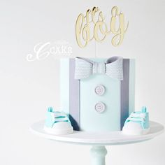 "Cindy Smith on Instagram: ""Welcoming a little man into the world with this cake complete with handmade fondant baby shoes and handpainted patterned bow tie  Cake topper: @caketoppersaus #cake #customcakes #cakedesign #babyshower #babyshowercake #itsaboy #babyboy #littleman #sugarart #edibleart #baking #cakedecorating #fondantshoes #cakeporn #instacake #cakestagram #cakegram #cakeartist #cakeporm #acdnmember #cute #edibleartpaint"""
