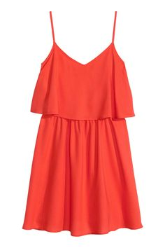 Coral red. Short dress in woven viscose fabric with adjustable shoulder straps, wide ruffle at top, and elasticized seam at waist. Gently flared skirt.