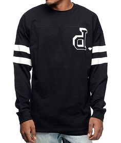 """Get your shine and athletic style on with the Un-Polo black long sleeve football jersey from Diamond Supply Co. The black colorway features a """"d"""" logo screen printed on the left chest and two athletic stripes on the sleeves finished with a velveteen flock"""