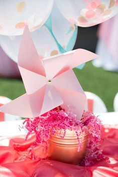 Pretty centerpieces at a polka dots and pinwheels birthday party! See more party ideas at CatchMyParty.com!
