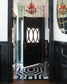 black door black trim, wallpaper, floor and red lantern. Classic modern with a play on pattern. Victoria Webster