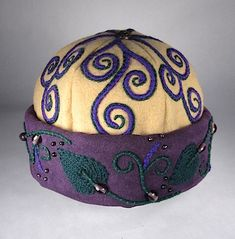 Hand-embroidered, beaded Venetian hat by Heather Daveno: http://www.augustphoenix.com/Venetian-Garden_p_136.html