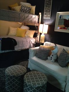 I love the white or grey main bedspread with cute pillows as an accent.