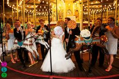 Shea and Todd Bastian at the Perth Zoo on their wedding day. Merry Go Round Wedding Photo