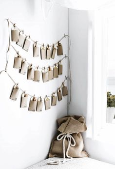 Detail: A creative take on an advent calendar comes together using tags and pegs from Paper2, while a Santa sack sets the mood for fun.