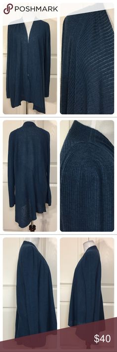Eileen Fisher Cardigan Gorgeous blue open front cardigan from Eileen Fisher. Lightweight wool. Small imperfection as shown on last pic. Sized XL. I think it fits smaller. Will mark a M. Wonderful layering piece! Eileen Fisher Sweaters Cardigans
