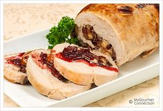 Boneless Cranberry-Stuffed Turkey Breast.This boneless,rolled turkey breast is stuffed with a combination of sourdough bread,dried cranberries,orange zest and rosemary and served with a delcious,citrus-scented pomegranate sauce.With all the flavor elements of a classic turkey dinner,this dish makes a nice change from a whole bird as well as a lovely presentation on any holiday table.