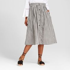 One of our favorite menswear twists, the Button-Front Skirt - Who What Wear™ captures that cool-girl casual look you love. The button-front brings preppy crispness to a new piece, while the unexpectedly soft fabric makes it a breathable, all-weekend favorite.