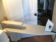 DIY Hide Away Ironing Board With White Door.  Love the sleeve board!