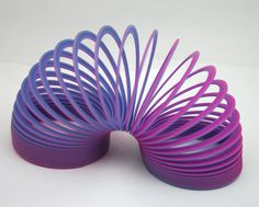 Vintage Toy, plastic slinky, purple, blue, walking spring toy, 1980s, executive desk ornament, relaxation