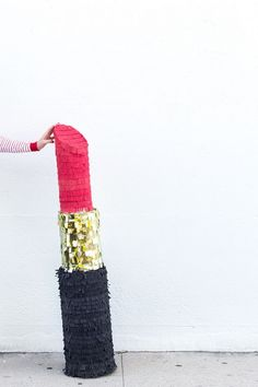 This DIY lipstick piñata is sure to make your Galentine's Day bash a smash.