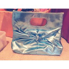 Metallic Blue Clutch  Metallic light blue hand held clutch. Lime green lining. Zip pocket inside. Magnetic snap closure. Great condition!   Bags Clutches & Wristlets