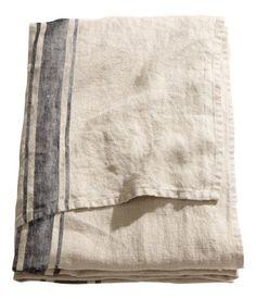 H&M Linen Tablecloth $59.95 to make pillows for the garden