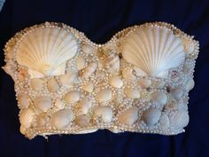 My DIY mermaid bra/top. Inspired by Kim Kardashian's beautiful mermaid costume from last year. All of the shells except the 2 large ones were found on the beach years ago and I finally used them. Pearls/beads all bought from craft stores. Simple cheap lace bustier I got years ago for the base. I wanted to use something with more coverage than a bra. Very easy and fun to make!!