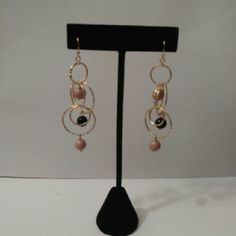 New York & Company Brand new never worn dangly gold earrings with little mauve and black balls. Very pretty! I have several pairs of these same earrings so please don't purchase this post. Let me know and I can make you a new listing! New York & Company Jewelry Earrings