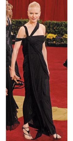 Worst dressed. unflattering straps and really stark pulled back hair Nicole Kidman in Jean Paul Gaultier (Oscars 2003)