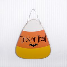 Trick-or-Treat wooden hanging candy corn - Halloween decorations | @adamsandcompany #adamsandco #Krumpets
