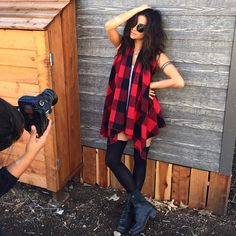 Shay Mitchell knows how to strike a pose. She looks so cool in this plaid scarf. | Pretty Little Liars