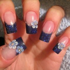 nice blue glittery nails with flowers