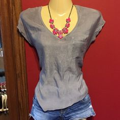 Silver pocket tee An oldie but a goodie! Super comfortable and cute express pocket tee! Looks adorable with a cardigan and a statement necklace!! Great comfortable material allows you to move!    Offers are welcome!!!!  15% discounts on bundles always  I ship orders out FAST!   NO TRADES NO PAYPAY  I ONLY SELL THROUGH POSH!! Express Tops Tees - Short Sleeve