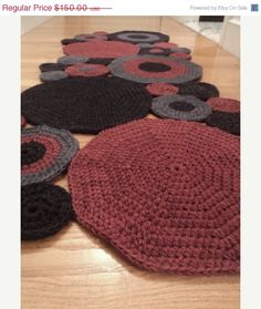 On Sale Hand Crocheted, Circle Runner Rug, wool on Etsy, $120.00. different colors, wish I could find actual patterns.