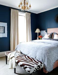 bedrooms - blue walls, zebra bench, ivory silk drapes, linen bed French brass nailhead trim, blue orange pillows, blue paisley blue duvet  Blue walls