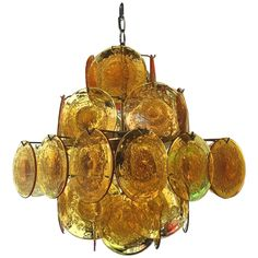 1960 Murano Amber Glass Light Design by Vistosi | From a unique collection of antique and modern chandeliers and pendants  at https://www.1stdibs.com/furniture/lighting/chandeliers-pendant-lights/