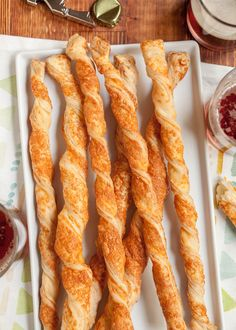 Dinner party plans stressing you out? Puff pastry cheese straws are here for you. These crispy, flaky, cheesy twists require just two ingredients and a few minutes of your time, and yet they deliver big — real big — out on the buffet table.