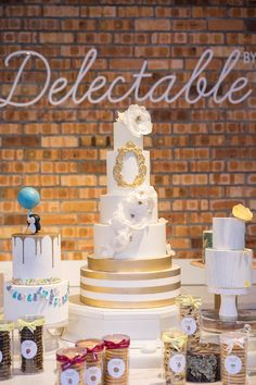 White and gold tiered wedding cake with gold vintage frame and sugar flowers // Top 10 Wedding Cake Creators in Malaysia - Part 1