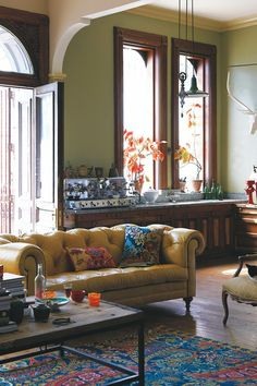 Everything about this space is amazing. The sofa is fabulous, the colors, textures, background, everything.