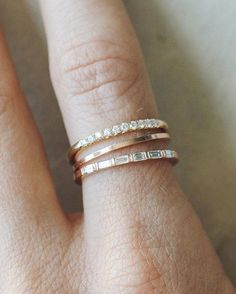 Stackers? Wedding bands? Same thing! As long as it's sparkles, it's good. Shop the link in our bio before they're all gone. Featured (top to bottom) — French Pavé stacker, 1mm Thread band, and the classy Dainty Baguette Stacker. Tag your girls