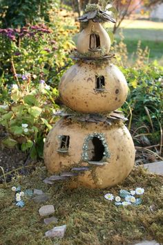 really cute fairy house made of a birdhouse gourd