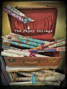 The Paper Collage - old suitcase rolled paper display...