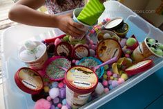 @Molly Wilson!! The kids would love this ice cream sensory table idea! I love it...better start eating a bunch of ice cream to collect the containers ;)