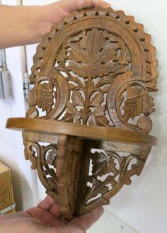 Ornate wood shelf.