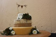 A country feel cheese wedding cake designed by Barossa Valley Cheese Company in Angaston, Barossa Valley in South Australia. Floristry by Miss Maggies Flowers also in Angaston.