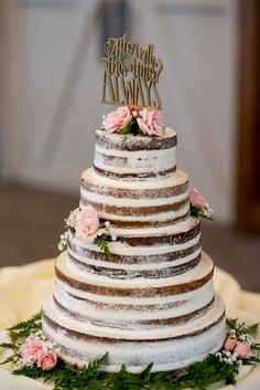 Rustic pink floral topped naked wedding cake: Bucking Tradition and Planning a Gorgeous Farm Wedding