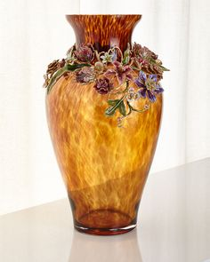 "Handcrafted vase. Made of mouth-blown glass and metal. Metal collar hand enameled and hand set with Swarovski crystals. 12""Dia. x 22""T. Made in the USA of imported materials."
