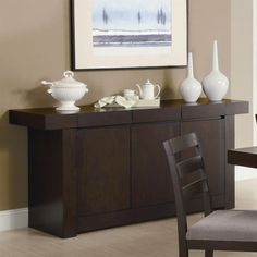 The storage drawers and space inside the cabinet doors make this Modern Dining Room Sideboard Server Table Cabinet in Cappuccino a fantastic addition to your dining room. The spacious top surface is i