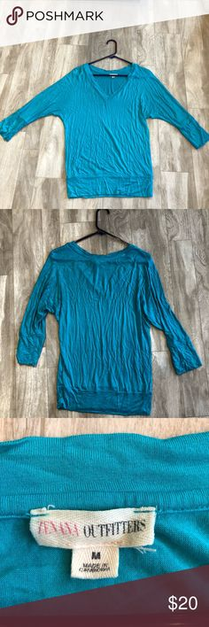 Blue shirt Cute blue shirt more loose on top and fitted at the waste. Super cute with a scarf. Size medium fits true to size. Last picture is most true to color! Matching grey in my closet as well. EUC just wrinkled Tops Blouses