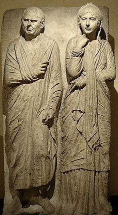 Tombstone carved in high relief on marble containing full-length portraits of a young woman and her older husband. From Via Statilia. 2nd quarter of 1st Century BCE. Rome: Museo Montemartini.