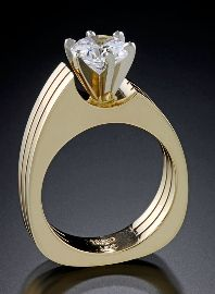 14kt yellow gold design ring with a 7mm Cubic Zirconia.  Style # 281293AA $1,500