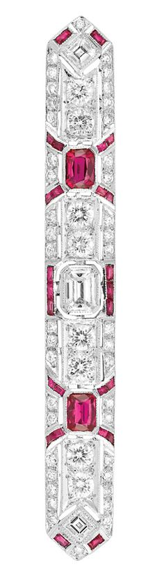 Ruby and Diamond Bar Brooch   18 kt. white gold, one emerald-cut diamond ap. .40 ct., 52 diamonds ap. 2.15 cts., 2 emerald-cut rubies ap. .90 ct., ap. 6.8 dwt. Art Deco or Art Deco style.