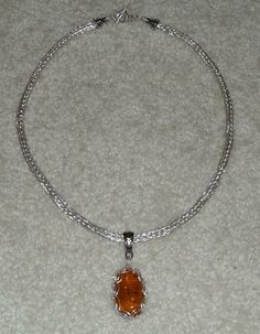 Dominican amber in viking weave setting on silver viking weave chain