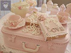 Pink vintage suitcase, book vignette