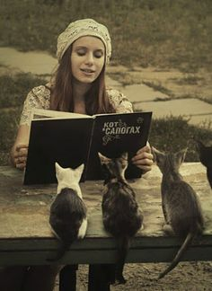 In Russian the girl is reading Puss in the Boots ;-)))