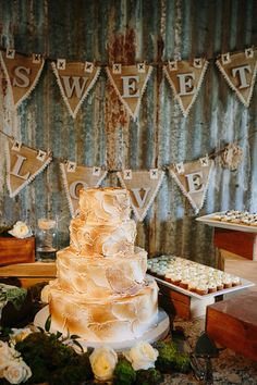 toasted marshmallow cake! | Caroline + Ben #wedding... for me.... rice krispy cake covered in toasted marshmallow frosting and some kind of homemade marshmallow decoration