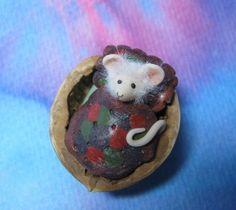 In a nutshell ...sleepy mouse in walnut shell OOAK SCULPT by Artist Ann Galvin. $15.00, via Etsy.